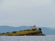 Leinwanddruck Bild - The Plocica lighthouse on a small island in the Adriatic sea