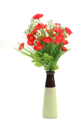 Red flowers in white flower pot, artificially