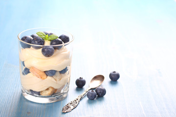 Fresh blueberry layered desert with mascarpone cream and cookies