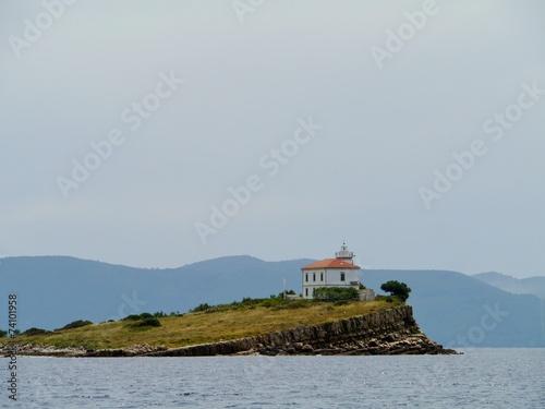 Leinwanddruck Bild The Plocica lighthouse on a small island in the Adriatic sea