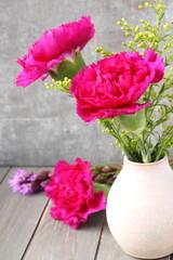 Pink carnations flower bouquet in vase