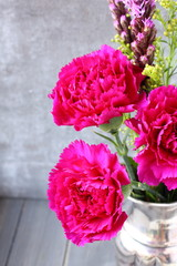 Pink carnations flower bouquet in metal  vase