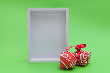 blank white wood frame and xmas ornaments