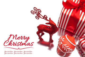 christmas deer, gift box and ornament on white background