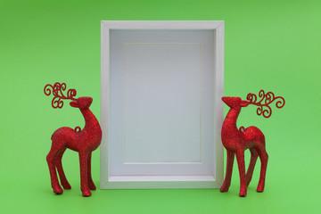 christmas deers and blank white wood frame