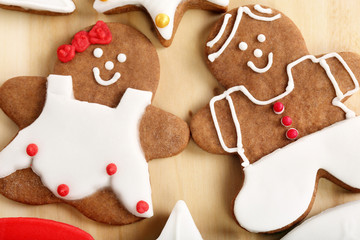 Christmas decorated gingerbread in shape of man and woman on the