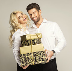 Cheerful couple with gifts