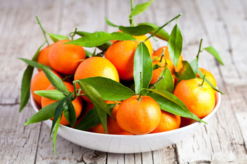fresh tangerines in a bowl