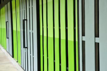 Warehouse gate closed, green and gray color