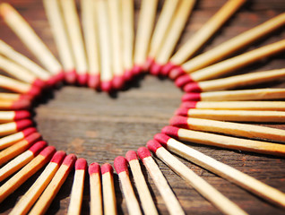 matchsticks in the shape of a heart toned with a warm filter