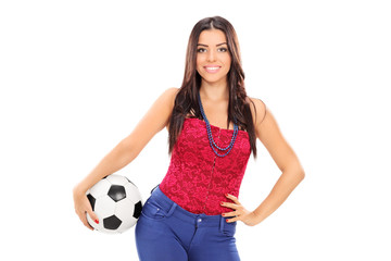 Attractive girl holding a football