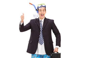 Businessman with diving equipment giving thumb up