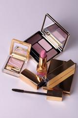 eyeshadow palette with mirror and lipsticks