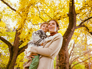 Mother and son enjoying autumn nature