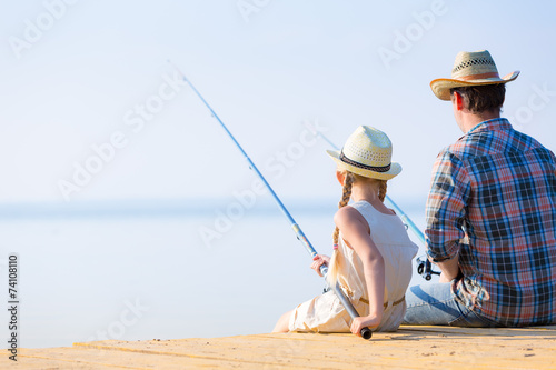 canvas print picture Father and daughter fishing