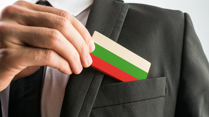 Man withdrawing a wooden card painted as the Bulgarian flag