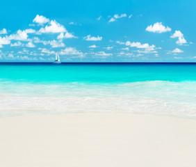 Yacht at tropical beach. Anse Georgette, Praslin island, Seychel