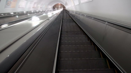 Descend on the escalator