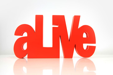 Close up shot of red Alive wording on white background