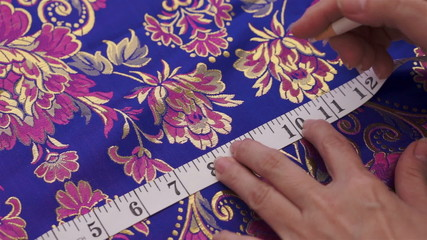 Seamstress Measuring and Marking Fabric