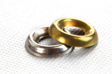 One brass and steel metal cup washers