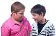 Two teenage boys having fun isolated on white background