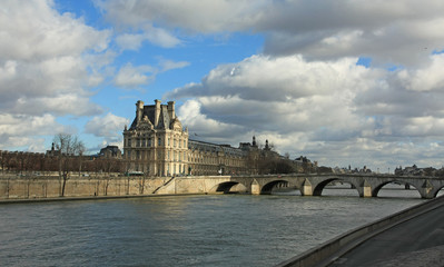 palace, seine river and bridge in paris