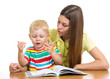 mother reading a book to child boy