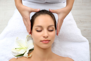 Portrait of beautiful woman taking head massage
