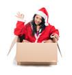 woman in Santa Claus dress sitting inside paper box