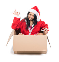 woman in Santa Claus dress sitting inside paper box