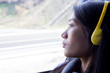 woman with headphones in a bus