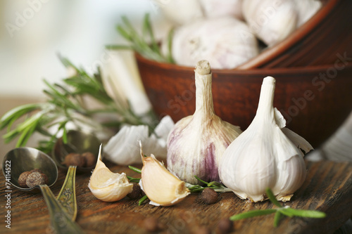 Fotobehang Kruiden 2 Raw garlic and spices on wooden table