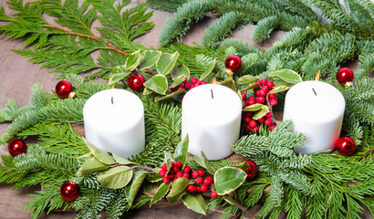 Three white candles in a centerpiece
