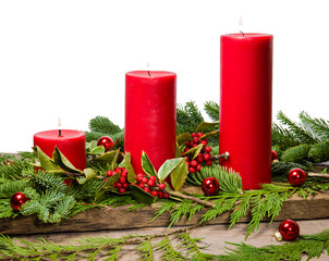 Red candles with cedar boughs