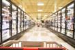Leinwanddruck Bild - an aisle in a grocery store showing frozen foods