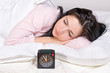 woman sleep in bed with alarm clock