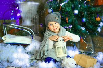 the girl near a Christmas fir-tree 8