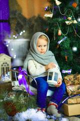 the girl near a Christmas fir-tree 9