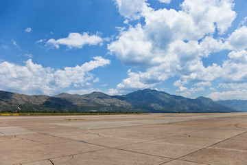 Runway of Dubrovnik Airport on a background of mountains.
