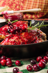 Glazing chicken breasts with cranberry sauce