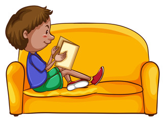 A boy reading while sitting down