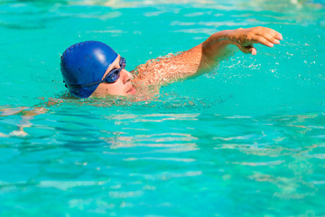 a young male engaged in sports swimming
