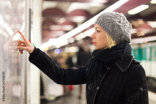 Lady looking on public transport map panel. - 74118591