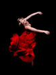 Young woman dancer in red dress