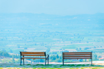 two empty benches and beautiful views of the valley