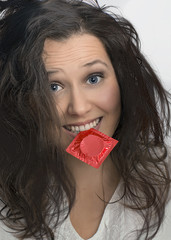 Girl with  with red condom pack
