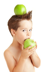 four years old boy eating an apple.