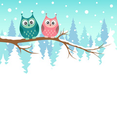 Two owls on a branch in winter forest