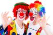 Leinwandbild Motiv lachende clowns machen handzeigen